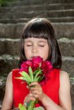 Charming little girl in a red dress Royalty Free Stock Photo