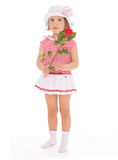 Charming little girl with red rose flower. Charming little girl in sailor dress with red rose flower. The concept of a happy childhood.Isolated on white Royalty Free Stock Image