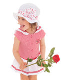 Charming little girl with red rose flower Stock Photo