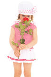 Charming little girl with red rose flower Stock Photos