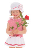 Charming little girl with red rose flower. Charming little girl in sailor dress with red rose flower. The concept of a happy childhood.Isolated on white Stock Photography