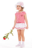 Charming little girl with red rose flower Royalty Free Stock Images