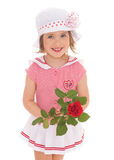 Charming little girl with red rose flower Royalty Free Stock Photo