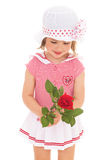 Charming little girl with red rose flower. Charming little girl in sailor dress with red rose flower. The concept of a happy childhood.Isolated on white Stock Photo