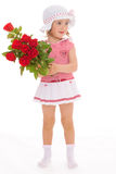 Charming little girl with red rose flower. Charming little girl in sailor dress with red rose flower. The concept of a happy childhood.Isolated on white Royalty Free Stock Photo
