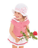 Charming little girl with red rose flower. Charming little girl in sailor dress with red rose flower. The concept of a happy childhood.Isolated on white Royalty Free Stock Photos