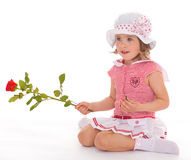 Charming little girl with red rose flower Royalty Free Stock Photos