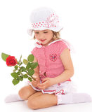Charming little girl with red rose flower. Charming little girl in sailor dress with red rose flower. The concept of a happy childhood.Isolated on white Royalty Free Stock Photography