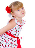 Charming little girl with red rose. In hair braided, half-length portrait. isolated on white background Stock Images