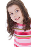 Charming little girl in a red striped dress. Royalty Free Stock Photo