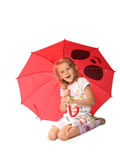 The charming little girl with red umbrella Royalty Free Stock Photos