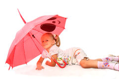 The charming little girl with red umbrella Royalty Free Stock Image