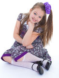 Charming Little Girl Sitting On The Floor. Royalty Free Stock Images