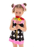 Charming little girl smelling a flower Royalty Free Stock Images