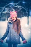Charming little girl in a snow.  Royalty Free Stock Photography