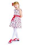 Charming little girl standing leg thrust forward Royalty Free Stock Image