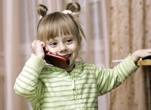 Charming little girl talking on the phone Royalty Free Stock Images