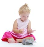 Charming little girl who is considering jewelry Stock Image