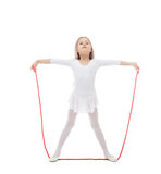 Charming little gymnast posing with skipping rope Stock Photos