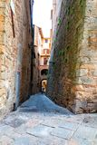Charming little tight narrow streets of Volterra town. In Tuscany, Italy, Europe stock photo