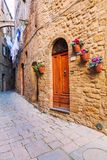 Charming little tight narrow streets of Volterra town. In Tuscany, Italy, Europe stock image