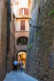 Charming little tight narrow streets of Volterra town. In Tuscany, Italy, Europe stock images
