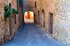Charming little tight narrow streets of Volterra town. In Tuscany, Italy, Europe royalty free stock image