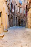 Charming little tight narrow streets of Volterra town. In Tuscany, Italy, Europe stock photos