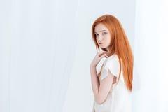 Charming looking back at camera. Charming redhead looking back at camera Stock Photos