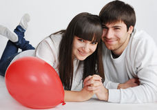 Charming love couple lying on the floor Stock Image