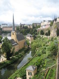 Charming Luxembourg City. A shot showing the authentic charm of Luxembourg City. Note the beautiful walled city separated by the natural foliage and the church Royalty Free Stock Image