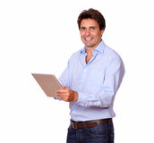 Charming male adult working on tablet pc Royalty Free Stock Image