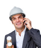 Charming male architect on phone. Against a white background Royalty Free Stock Image
