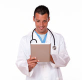 Charming male doctor working with his tablet pc Stock Image