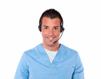 Charming male nurse with earphone smiling Stock Photo