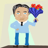 Charming man with flowers Royalty Free Stock Image