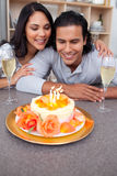 Charming man and his wife celebrating his birthday. In the kitchen Royalty Free Stock Photo