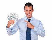 Charming man holding and pointing his dollars Stock Photography