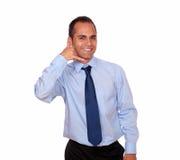 Charming man looking at you saying call me Stock Photo