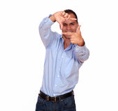 Charming man making a frame with his hands Royalty Free Stock Photos