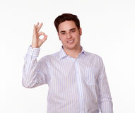 Charming man with ok gesture smiling Royalty Free Stock Photography