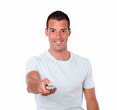Charming man pointing with remote control Stock Images