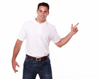Charming man pointing to his left Royalty Free Stock Images
