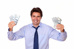 Charming man smiling and showing you cash money Royalty Free Stock Photo