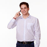 Charming man speaking on his cellphone Royalty Free Stock Images