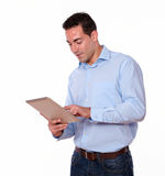 Charming man using his tablet pc Royalty Free Stock Photo