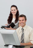Charming manager checking her employee's work Stock Images