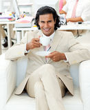 Charming manager drinking a tea Royalty Free Stock Images