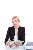 Charming mature businesswoman sitting at table. Stock Photos