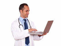 Charming medical doctor using his laptop Royalty Free Stock Photo